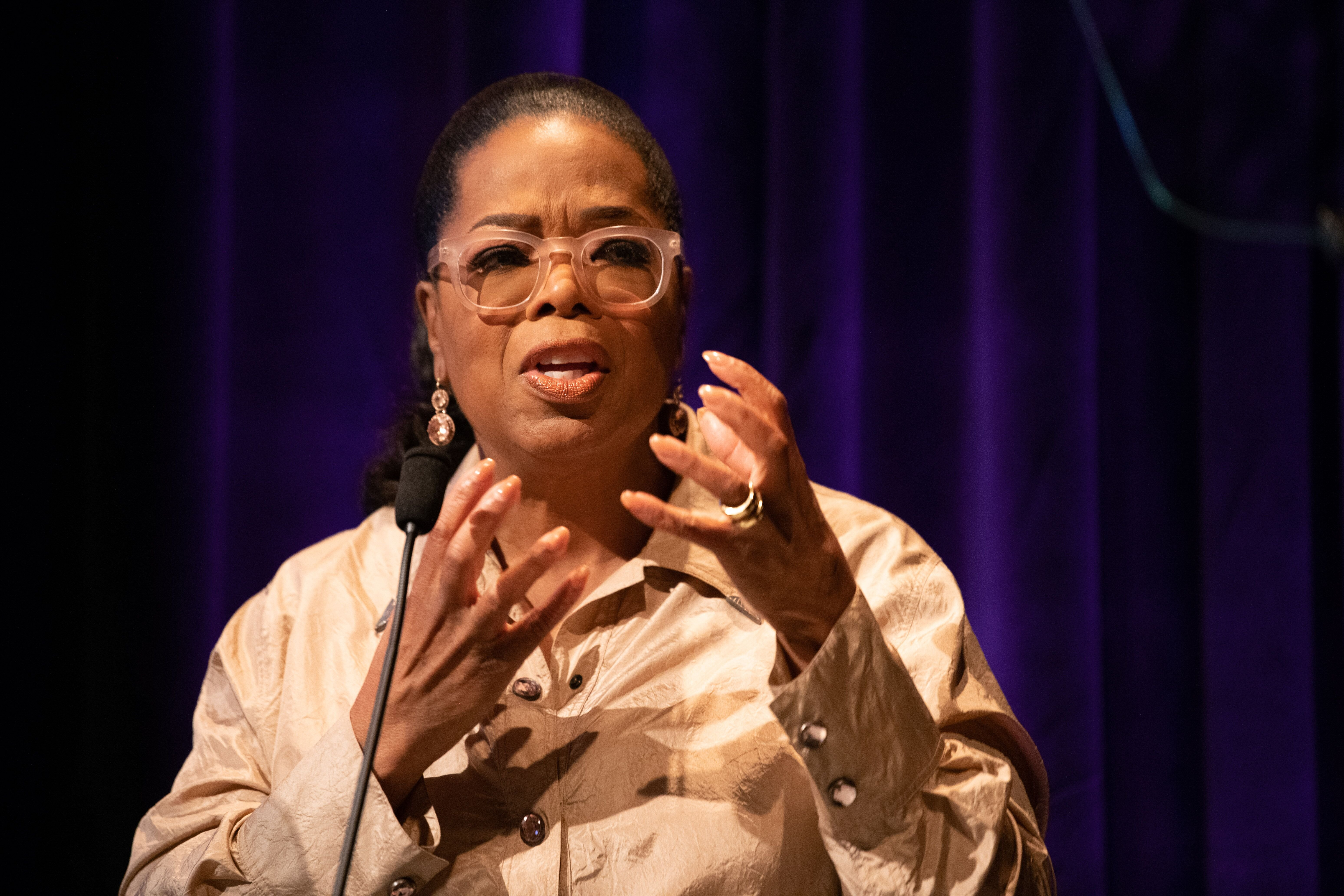 Oprah Winfrey speaks onstage at the Women's E3 Summit. | Source: Getty Images