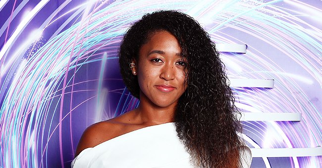 Naomi Osaka Poses in a Colorful Dress While Flaunting Her Curly Hair & a Chic Louis Vuitton Bag