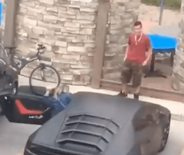 Man who pretended a Lamborghini belonged to him smiles slightly when he realizes that he was found out | Photo: TikTok/babyjayb