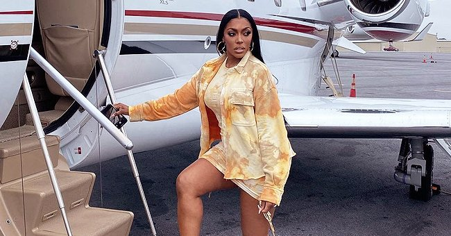 Porsha Williams Looks Cool Posing near a Private Jet in a Yellow Dress with Matching Jacket