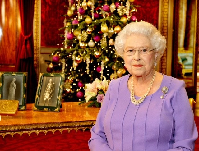 Queen Elizabeth II poses in the State Dining Room of Buckingham Palace after recording her Christmas Day television broacast on December 10, 2014 | Source: Getty Images/GlobalImagesUkraine