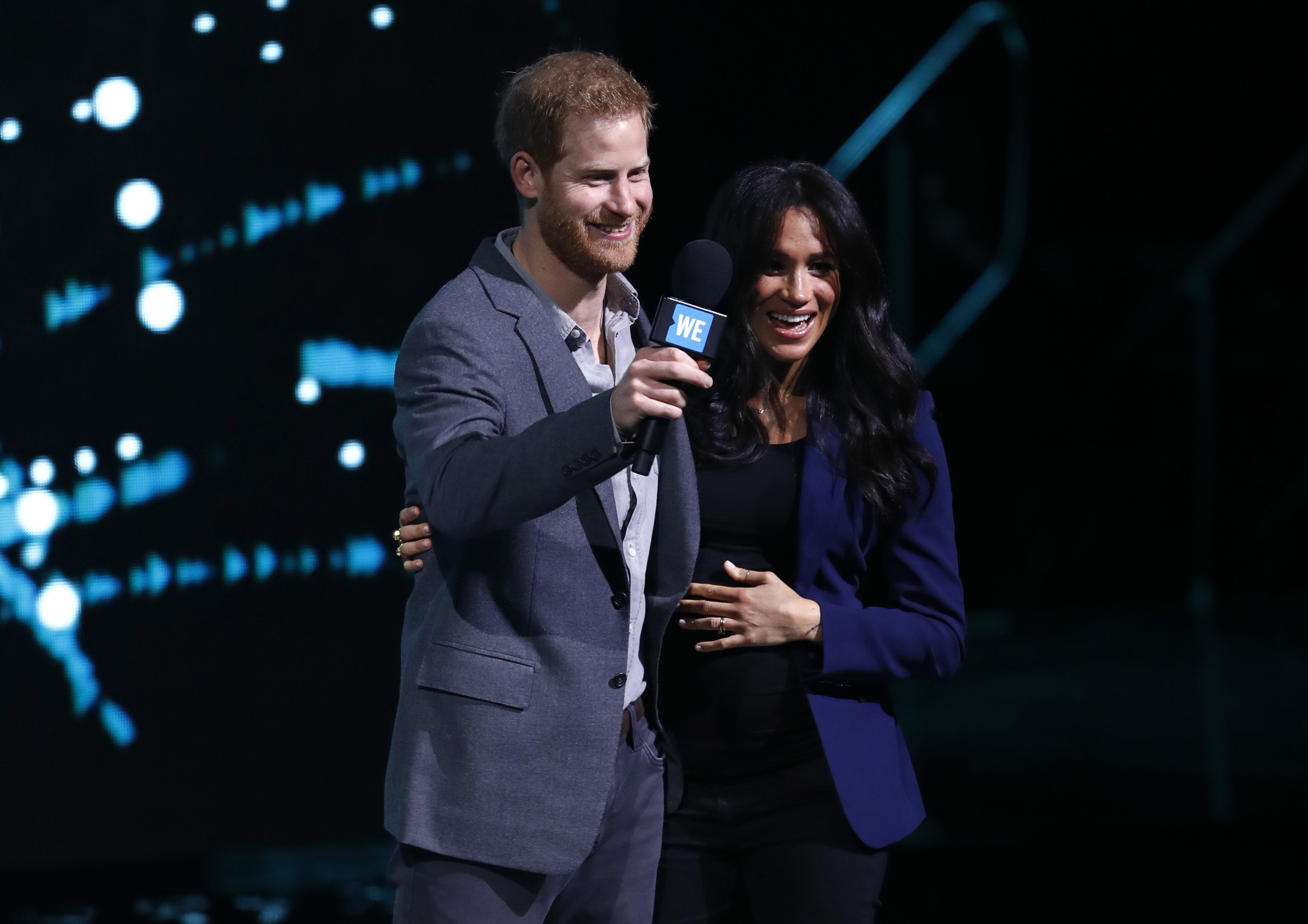 Prince Harry and Meghan Markle speak on stage during WE Day UK 2019 at The SSE Arena on March 06, 2019 in London, England   Photo: Getty Images