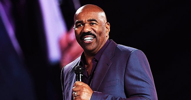 Steve Harvey Wears Purple Suit While Doing His Own Ironing in Video