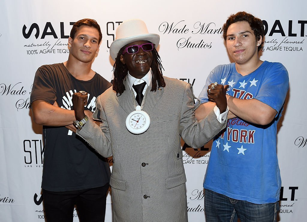 Rapper Flavor Flav (C) and Muhammad Ali's grandsons Biaggio Ali-Walsh (L) and Nico Ali-Walsh (R) attend producer Wade Martin's premiere of music videos by Flavor Flav and Coolio | Source: Getty Images