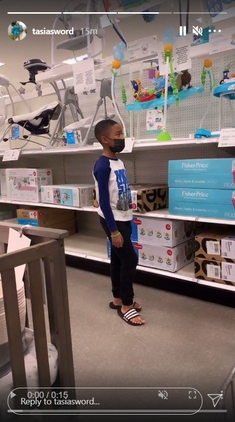 Dallas Xavier Barrino looking at baby chairs at a store. | Photo: Instagram/tasiasword