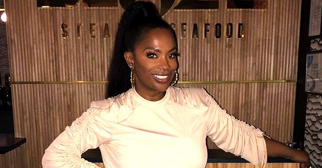 Kandi Burruss' Stepdaughter Kaela Stuns Rocking a Knitted Striped Dress with Thigh-High Boots