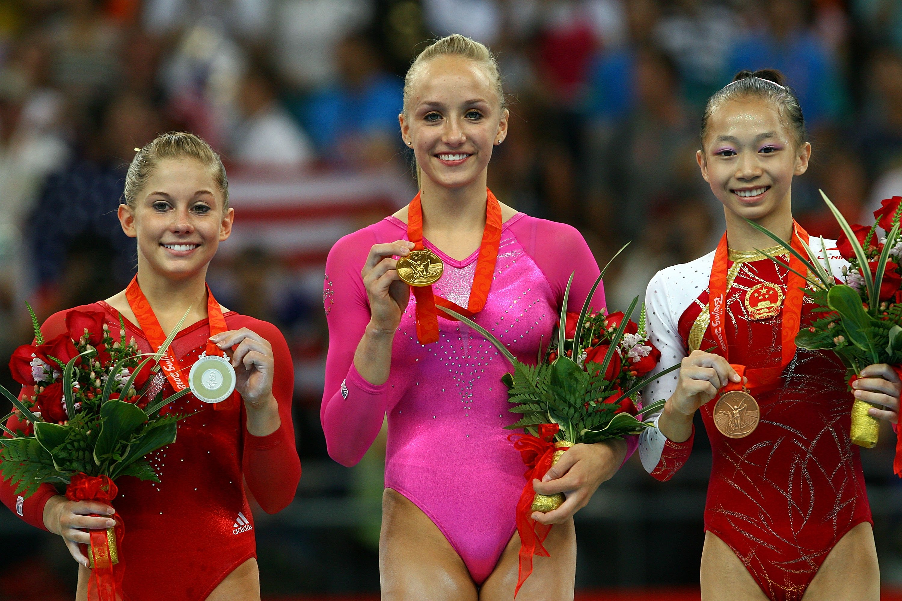 (L-R) Silver medalist Shawn Johnson of the United States, gold medalist Nastia Liukin of the United States and bronze medalist Yang Yillin of China pose together on the podium after competing in the women's individual all-around artistic gymnastics final at the National Indoor Stadium on Day 7 of the Beijing 2008 Olympic Games on August 15, 2008 in Beijing, China   Photo: Getty Images