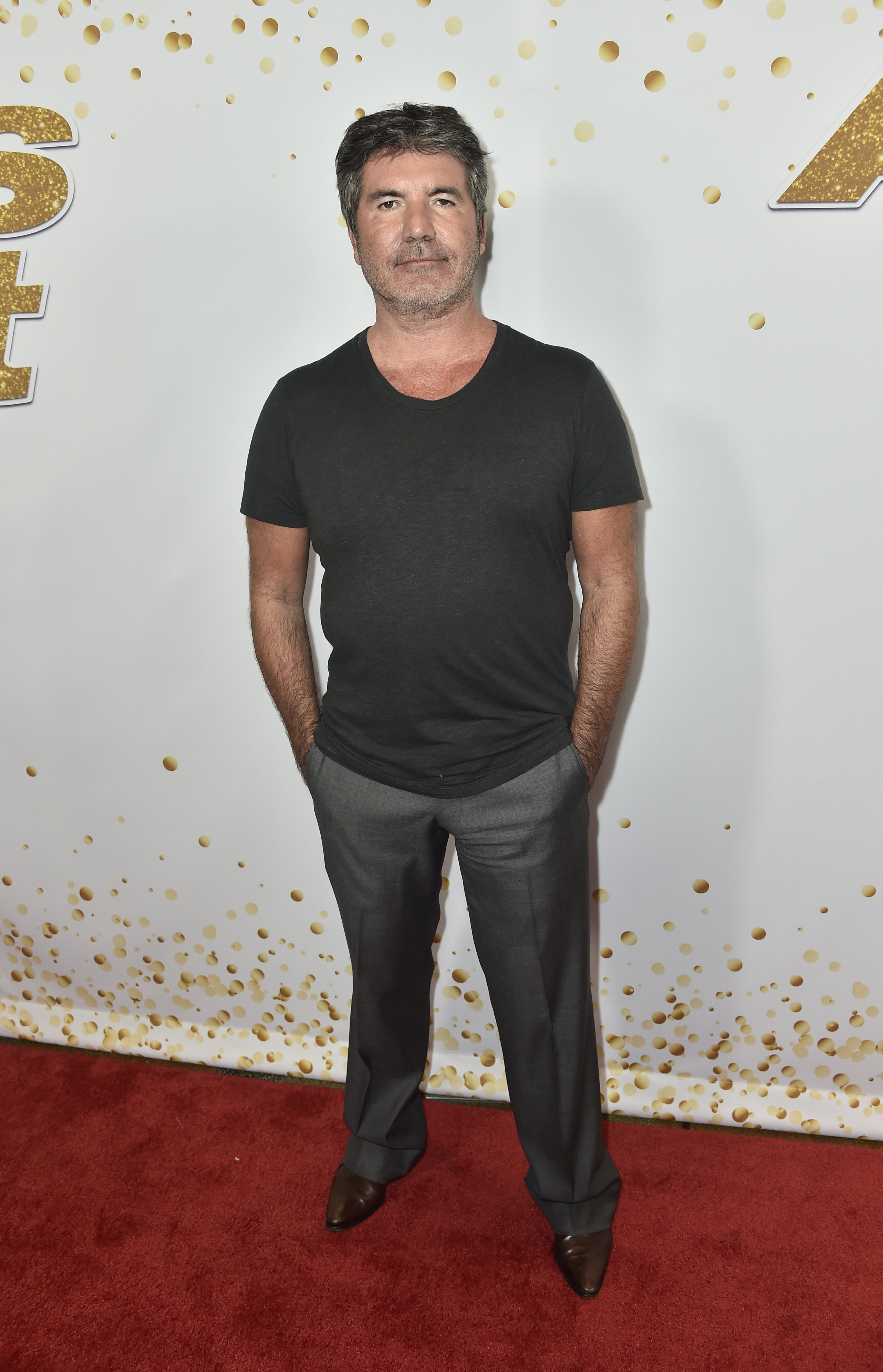 "Simon Cowell attends ""America's Got Talent"" season 13 Live Show Red Carpet in Hollywood, California on August 28, 2018 