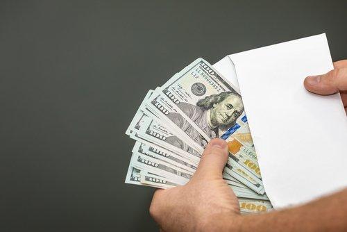 Cash in an envelope. | Source: Shutterstock.