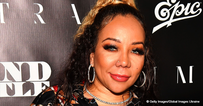 Tiny Harris Looks like She's Aging Backwards, Sporting Camo Top & Ripped Shorts in Pic
