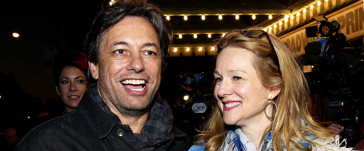 """Marc Schauer and wife Laura Linney pose at the opening night arrivals for """"Springsteen on Broadway"""" at The Walter Kerr Theatre on October 12, 2017 