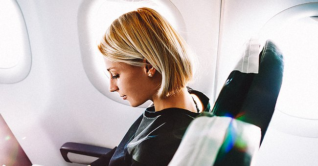 A lady in a plane.   Photo: Shutterstock