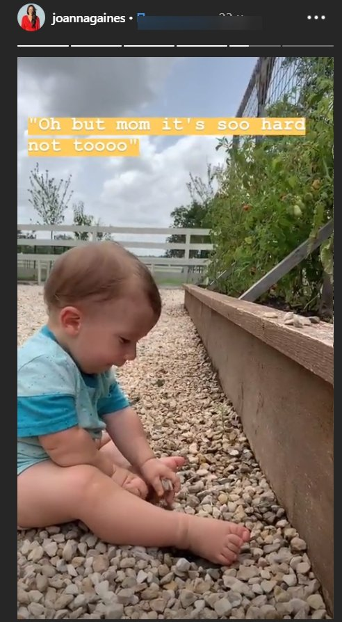 Joanna Gaines' son Crew Gaines playing with stones he'd rather eat | Photo: Instagram Story/Joanna Gaines