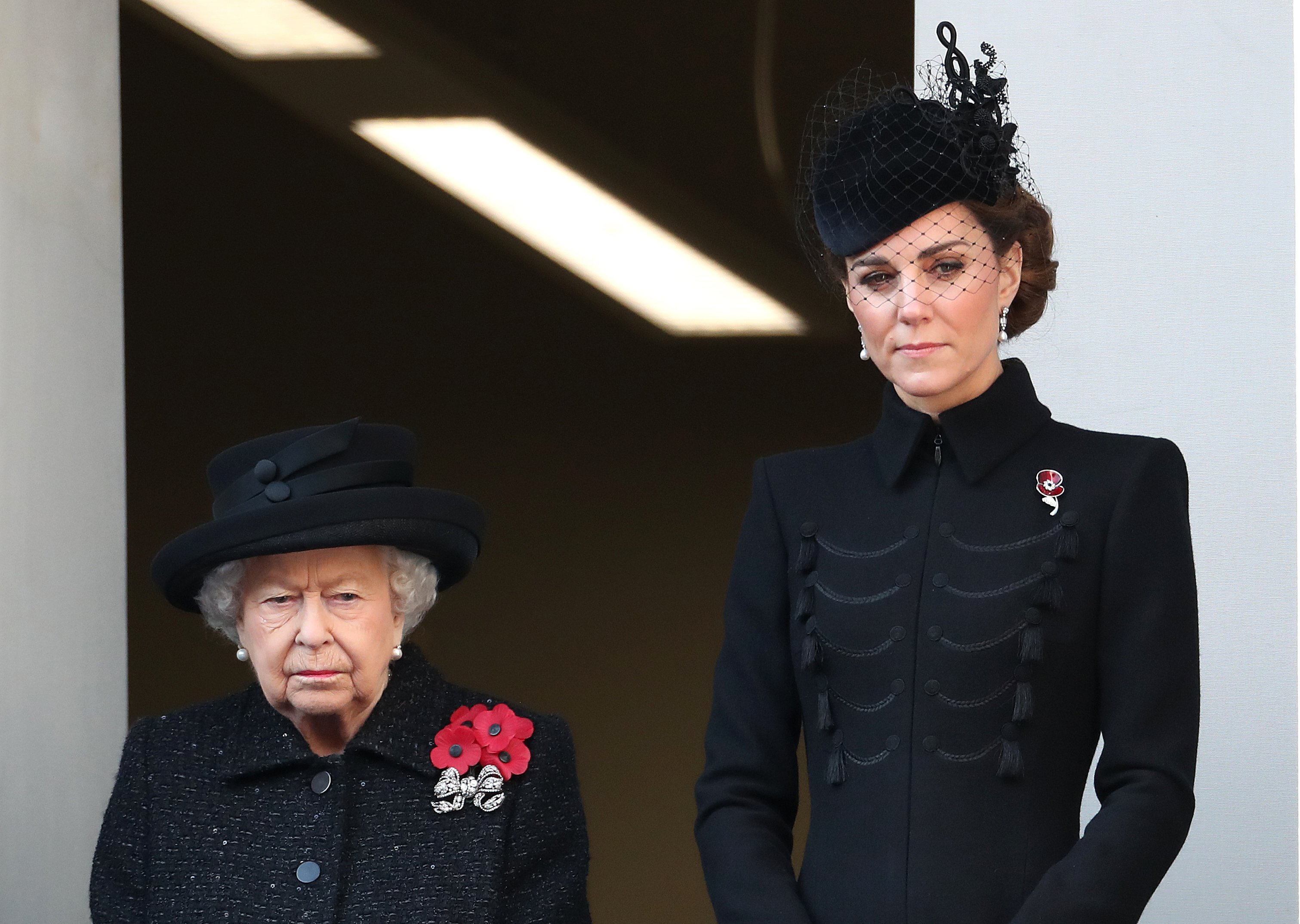 Kate Middleton standing next to Queen Elizabeth at the annual Remembrance Sunday memorial at The Cenotaph in London, England