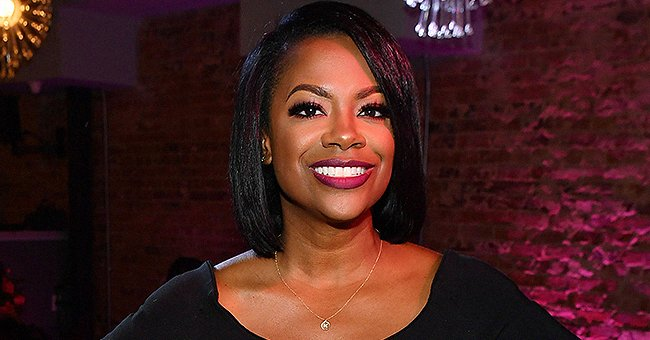 Kandi Burruss Flashes Her White Smile While Posing with Curtiss Cook in a New Photo