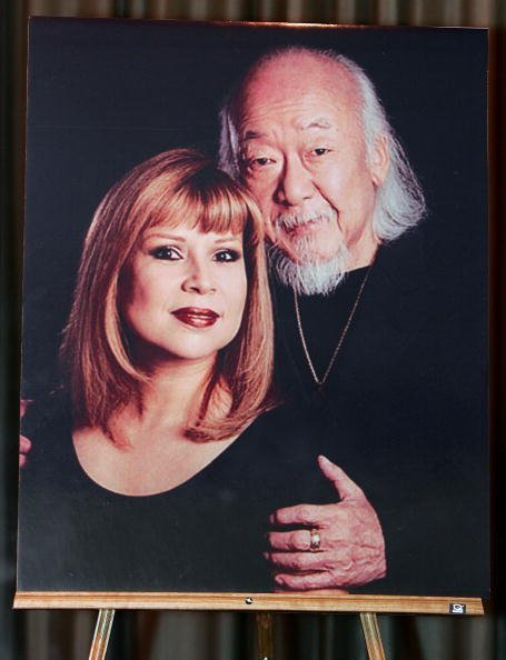 A photo of Pat Morita and his wife Evelyn is displayed during a memorial service for him at the Palm Mortuary & Memorial Park November 30, 2005 in Las Vegas, Nevada | Photo: Getty Images