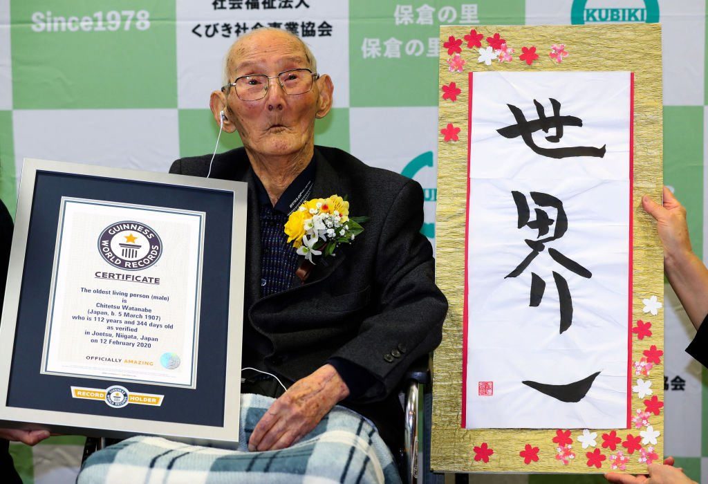 112-year-old Chitetsu Watanabe poses with the certificate and calligraphy as he is recognised as the World's Oldest Man by the Guinness World Record on February 12, 2020 in Joetsu, Niigata, Japan | Photo: Getty Images