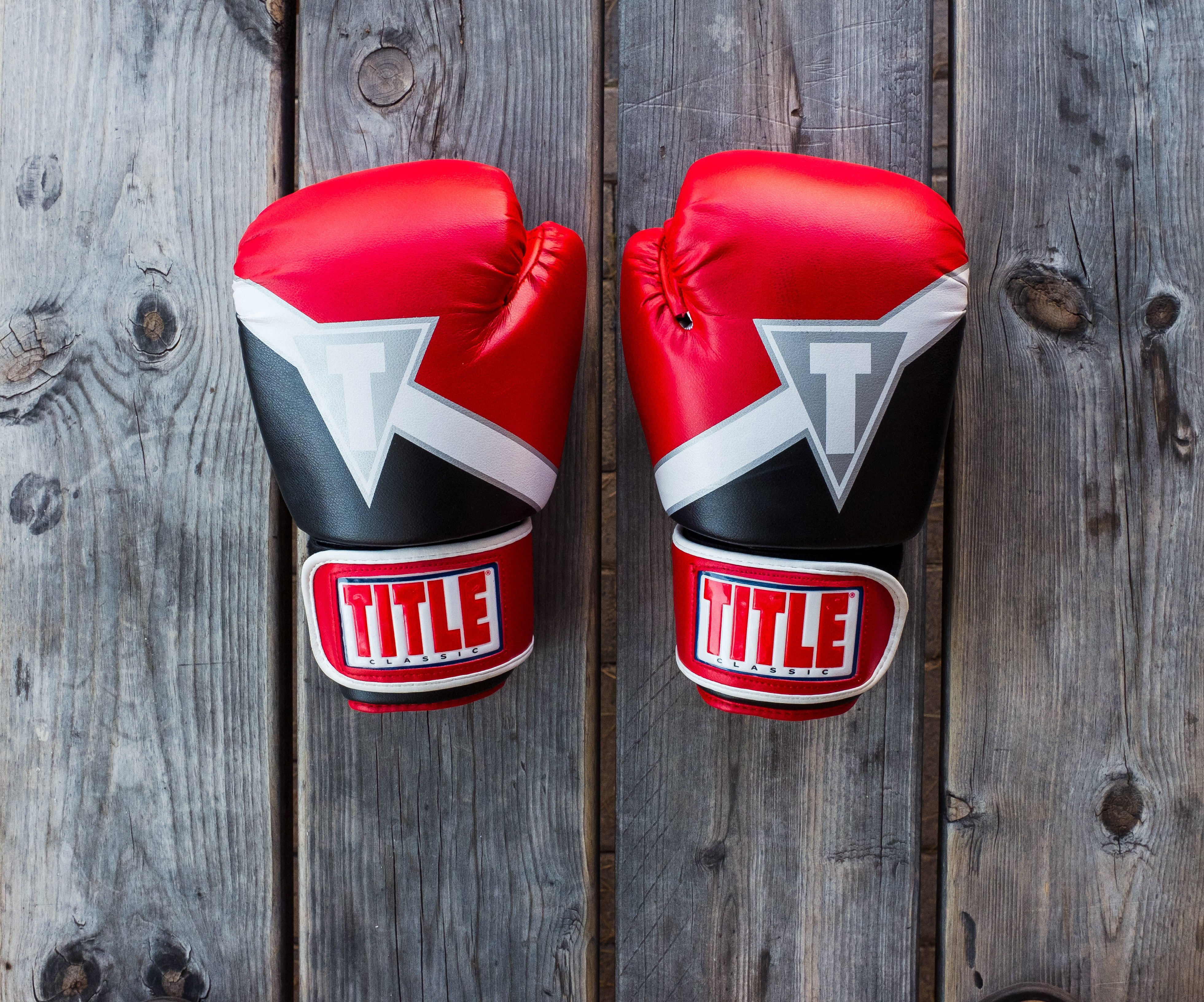 Pair of boxing gloves | Source: Unsplash / NeONBRAND