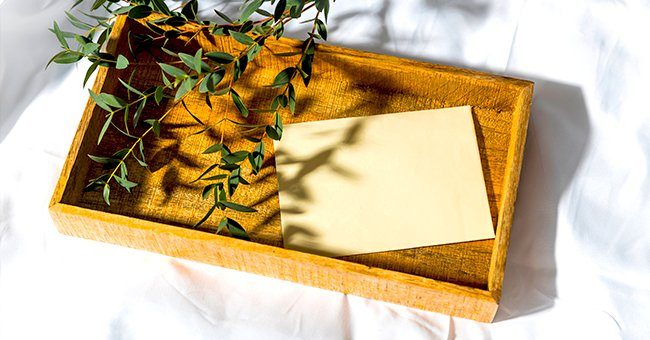 A envelope lies in a wooden box waiting to be opened. | Photo: Shutterstock