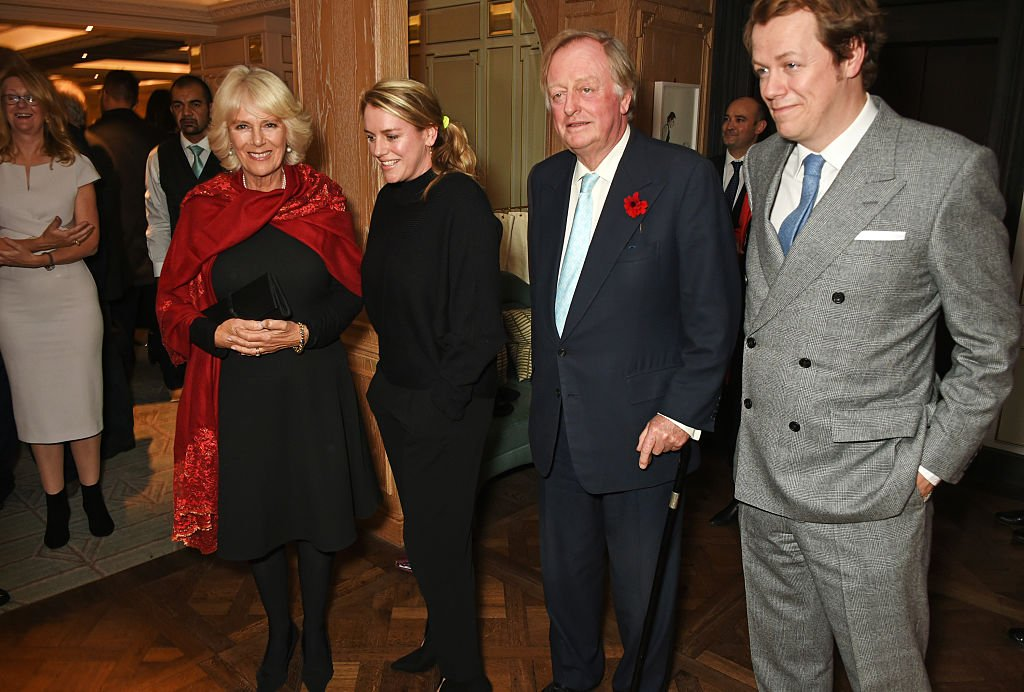 """Camilla, Duchess of Cornwall, Laura Lopes, Andrew Parker Bowles and Tom Parker Bowles attend the launch of """"Fortnum & Mason: The Cook Book"""" by Tom Parker Bowles at Fortnum & Mason on October 18, 2016 in London, England. 
