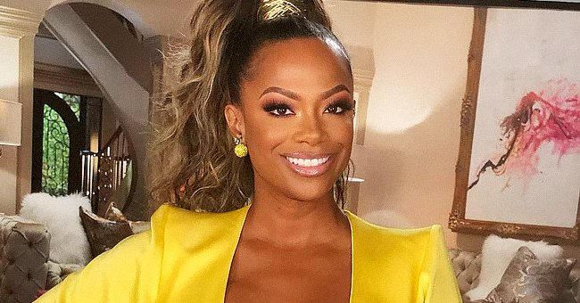 RHOA's Kandi Burruss Turns the Heat up Posing in Tight Snake-Print Pants With a Matching Jacket
