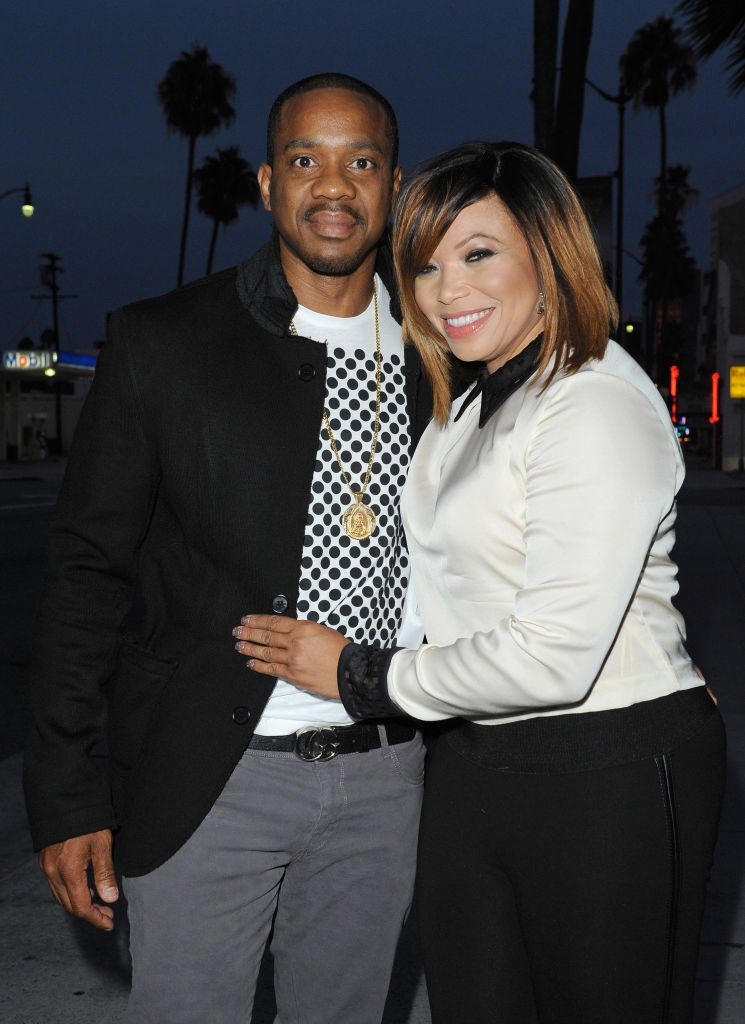 Duane Martin and actress Tisha Campbell attend Vivica A. Fox's 50th birthday celebration at Philippe Chow on August 2, 2014 | Photo: Getty Images