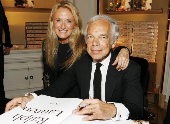Ralph Lauren (R) signing his book with his wife Ricky Lauren (L) attend the celebration of Ralph Lauren's 40th Anniversary at Bergdorf Goodman on October 18, 2007, in New York City. | Source: Getty Images.