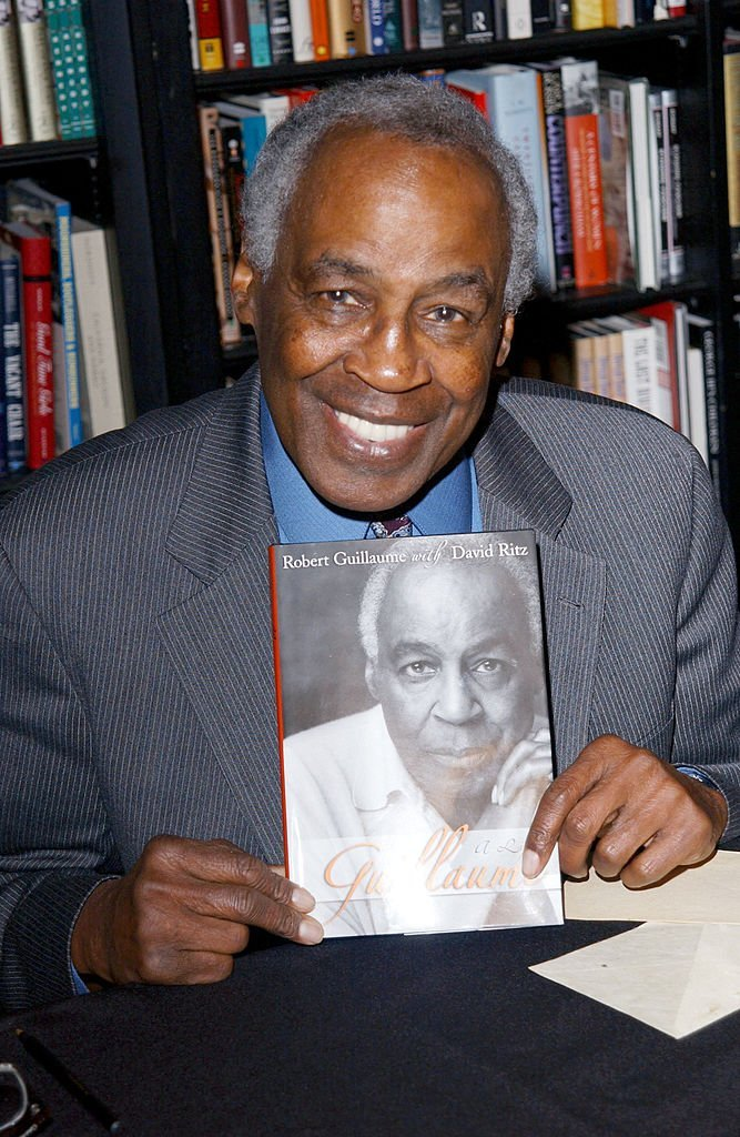 """Robert Guillaume signs his new book, """"Guillaume: A Life,"""" at Book Soup on November 25,2002. 
