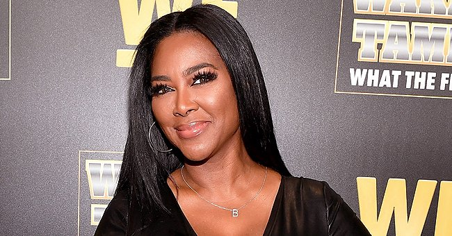 Kenya Moore Puts Her Derrière on Display Running on a Beach in a Nude Top with Matching Pants
