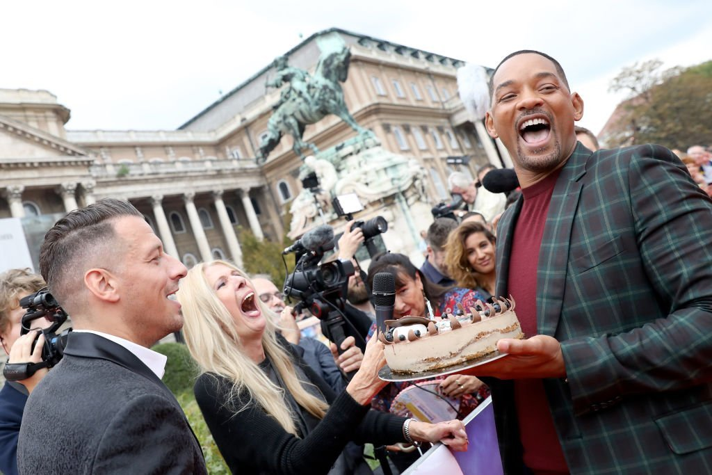 """Will Smith poses with a birthday cake to celebrate his 51st birthday at the """"Gemini Man"""" Budapest red carpet in Hungary on Sept. 25, 2019 
