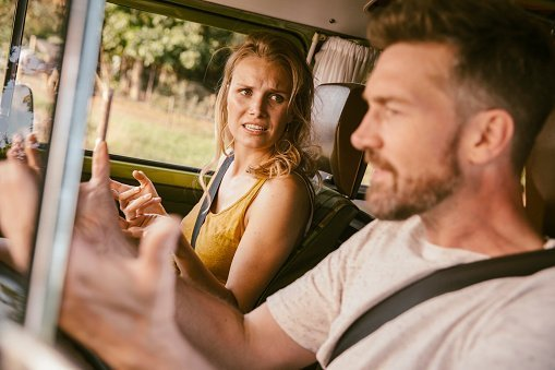 A couple pictured arguing in van on a road trip | Photo: Getty Images