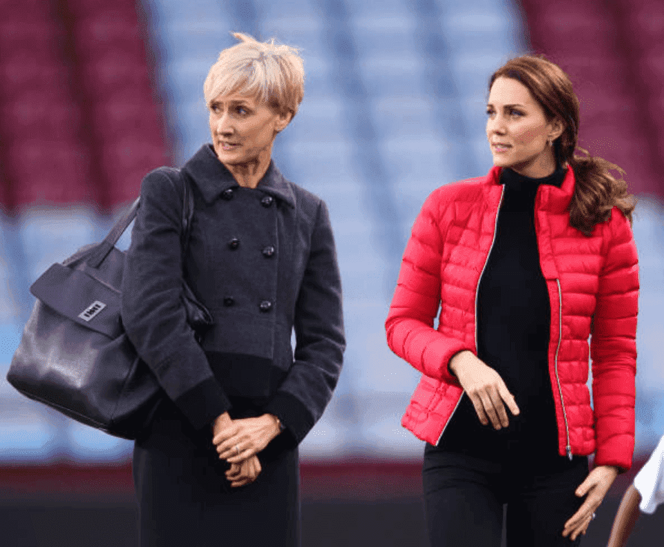 Kate Middleton stand on a soccer field with her private secretary, Catherine Quinn during a visit to Aston Villa Football Club, on November 22, 2017, in Birmingham, England. | Source: Max Mumby/Indigo/Getty Images