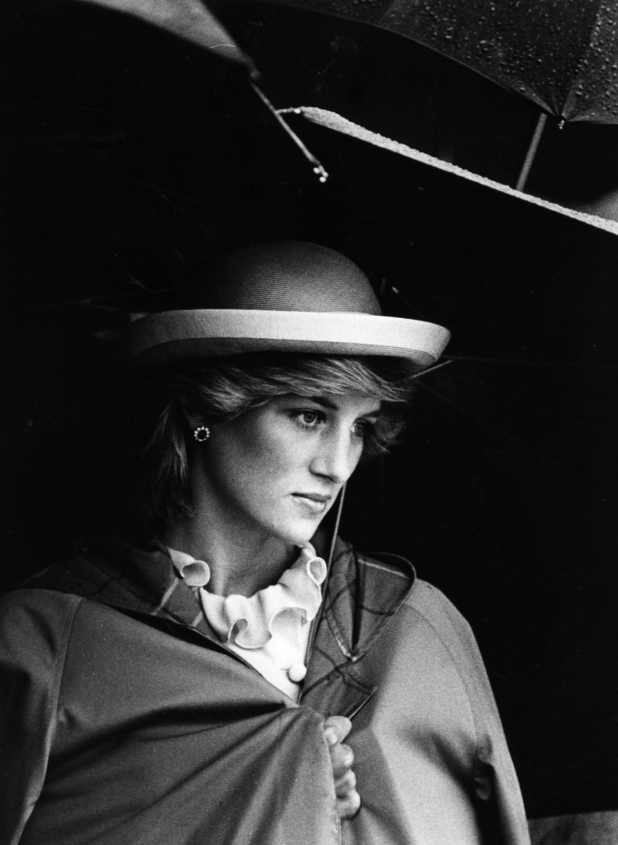Princess Diana pictured under an umbrella. 1983. | Photo: Getty Images