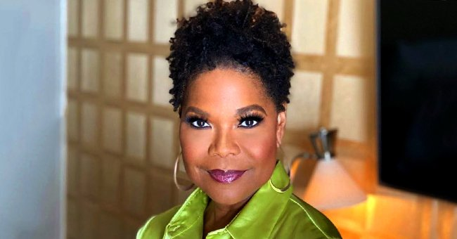 Angela Robinson of HAHN Fame Stuns with Her Natural Hair and Green Silk Shirt in Gorgeous Photo