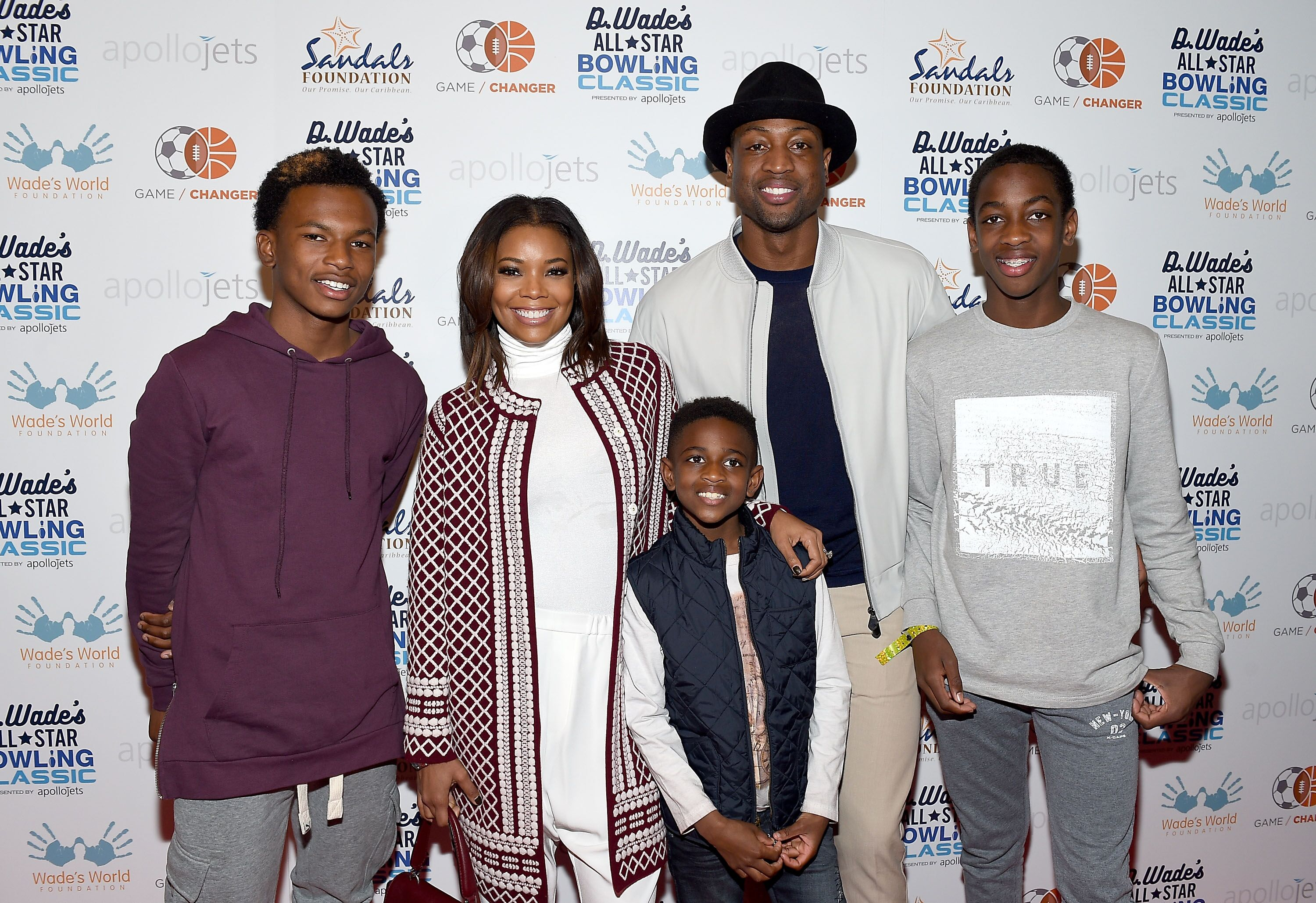 Gabrielle Union and husband Dwyane Wade and sons Zion, Xavier and Zaire at the All Stars Bowling Classic/ Source: Getty Images