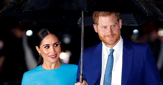 Meghan Smiles & Holds Hands with Harry as They Attend 1st Royal Event since Returning to the UK