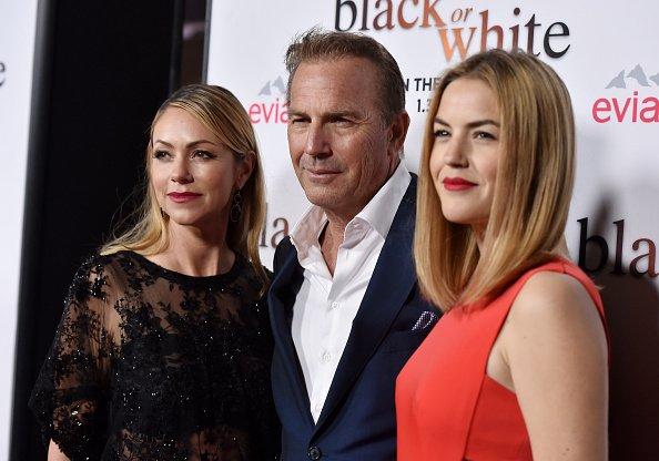 Kevin Costner, Christine Baumgartner und Tochter Lily Costner, L.A., 2015 | Quelle: Getty Images