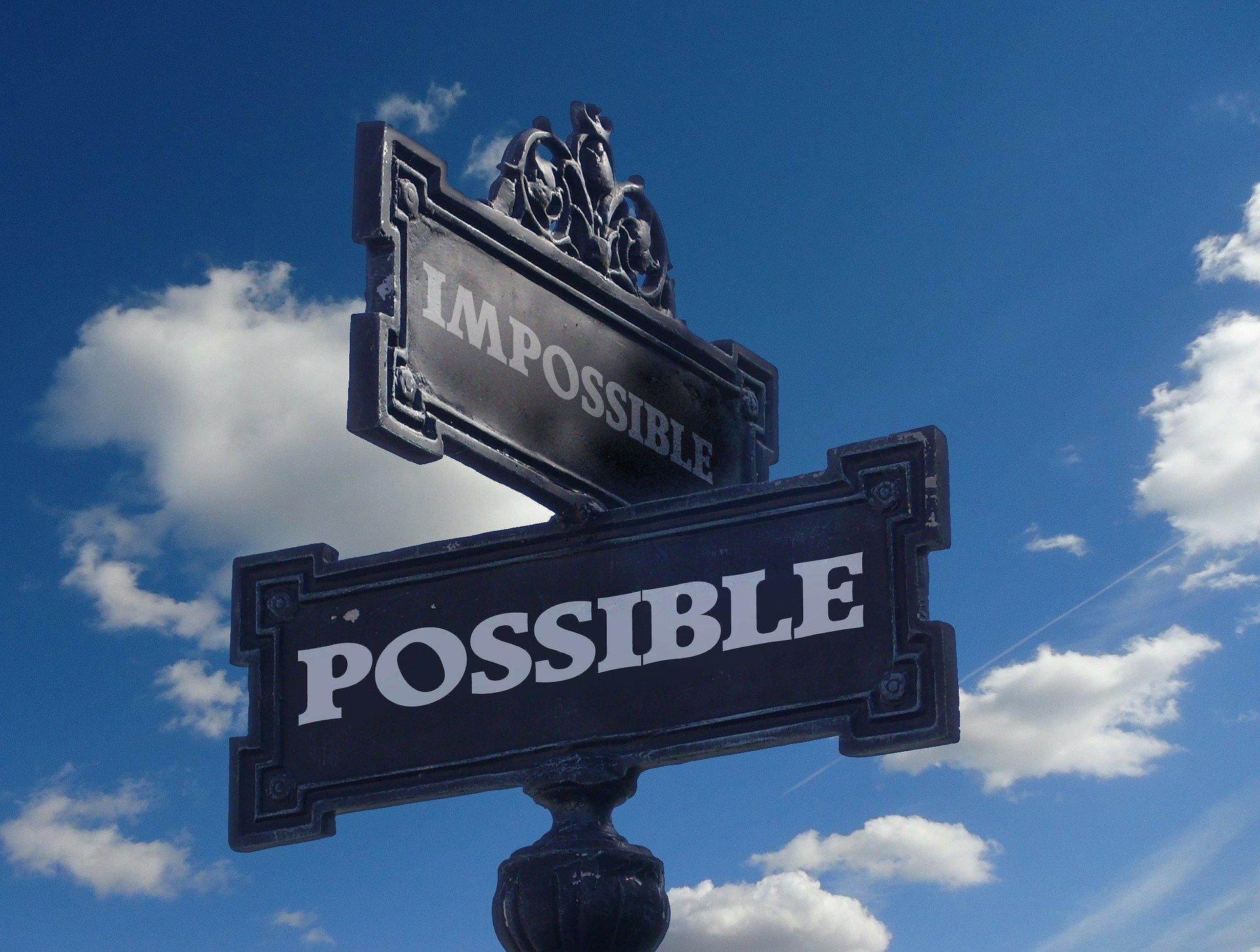 "A streetsign supposedly pointing towards the ""impossible"" and the ""possible."" 