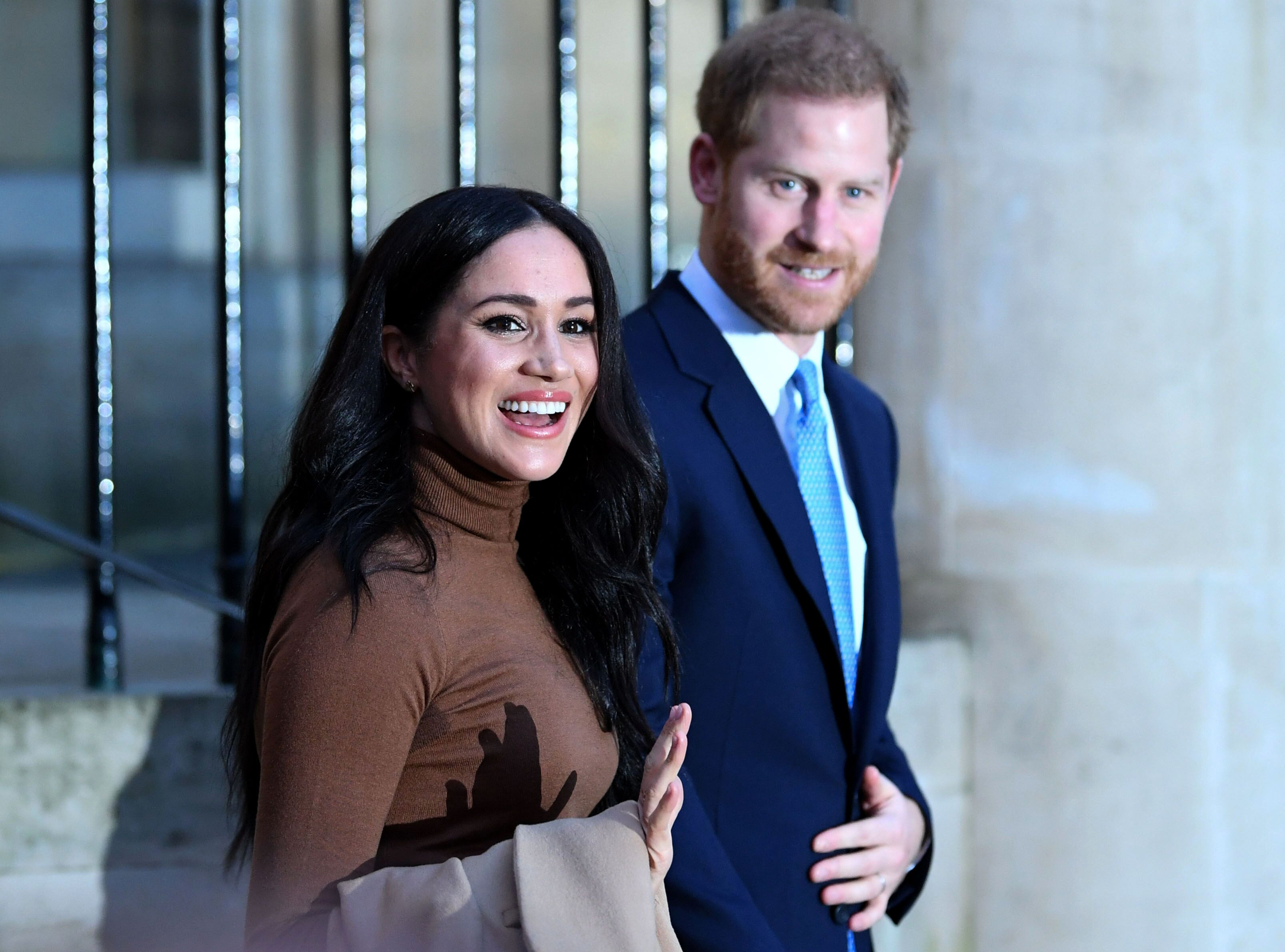 Prince Harry and Meghan Markle react after their visit to Canada House. | Source: Getty Images