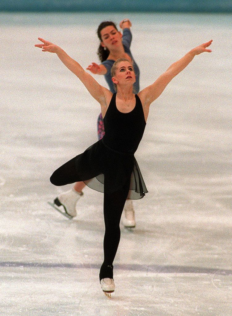 onya Harding (front) of the United States and compatriot Nancy Kerrigan skate during a practice session 22 February 1994 in Hamar, near Lillehammer, at the XVIIth Winter Olympic Games. | Source: Getty Images