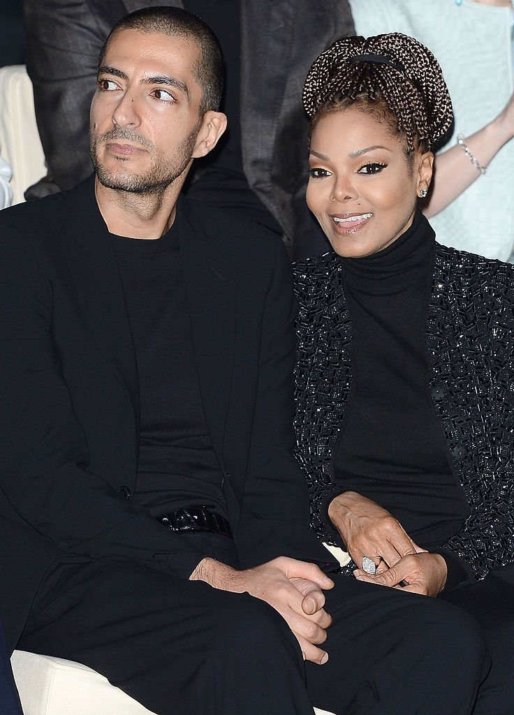 Wissam al Mana and Janet Jackson attend the Giorgio Armani fashion show during Milan Fashion Week Womenswear Fall/Winter 2013/14 on February 25, 2013 | Photo: Getty Images