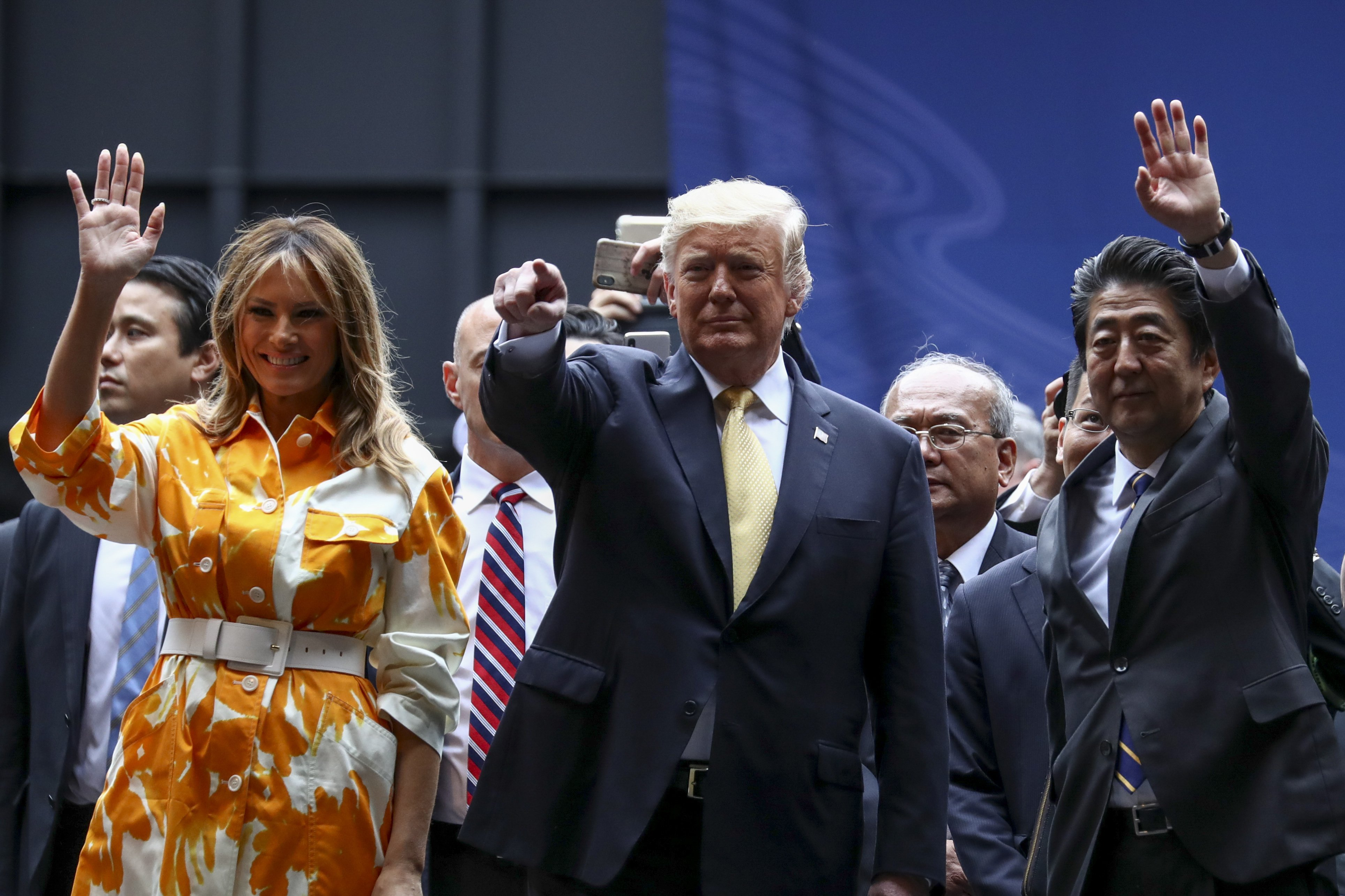 Donald Trump, Melania Trump and Shinzo Abe aboard the helicopter carrier DDH-184 Kaga in Tokyo, Japan   Photo: Getty Images