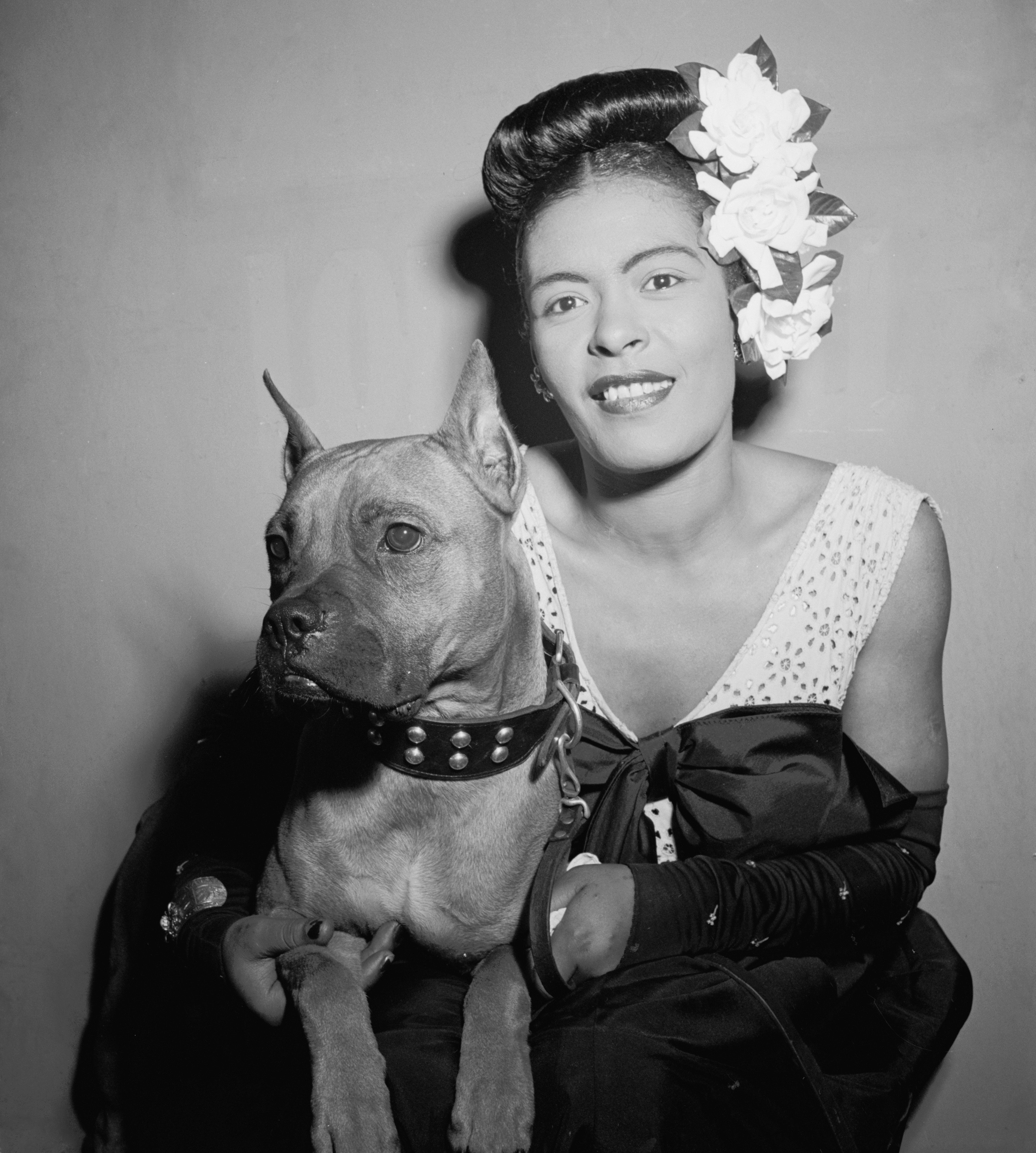 Billie Holiday and Mister, at the Downbeat Club in New York in 1947 | Source: Wikimedia