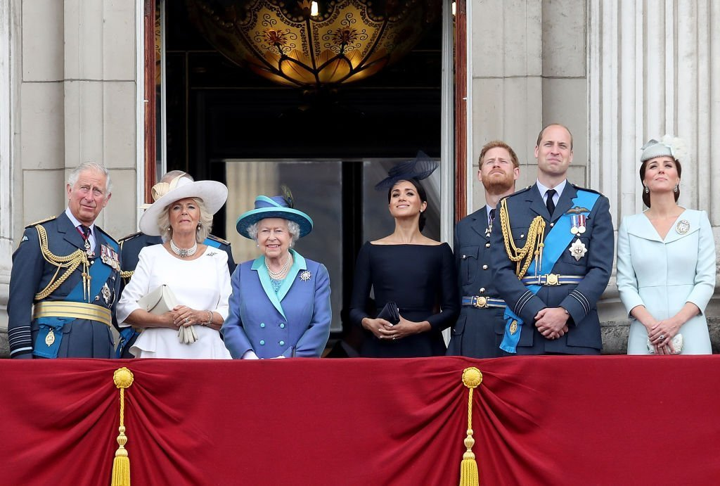 Prince Charles, Prince of Wales, Camilla, Duchess of Cornwall, Queen Elizabeth II, Meghan, Duchess of Sussex, Prince Harry, Duke of Sussex, Prince William, Duke of Cambridge and Catherine, Duchess of Cambridge watch the RAF flypast on the balcony of Buckingham Palace. | Photo: Getty Images