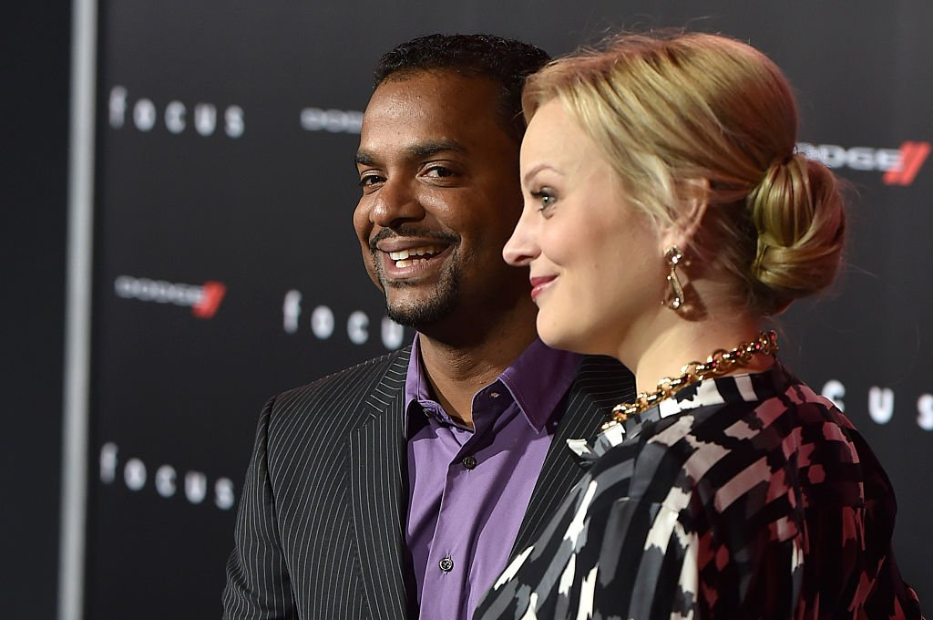 "Actor Alfonso Ribeiro (L) and wife Angela Unkrich attend the premiere of Warner Bros. Pictures' ""Focus"" at TCL Chinese Theatre 