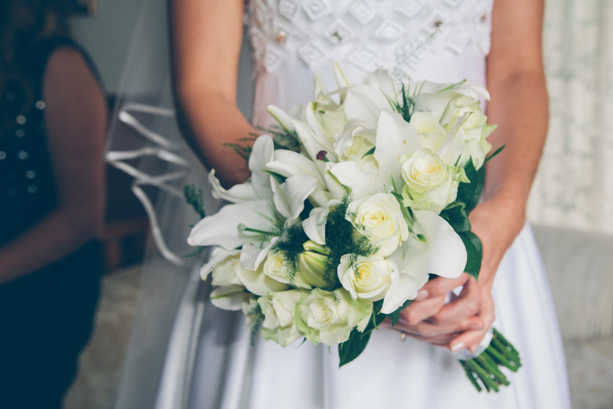 Bride holding a bouquet.   Photo: Getty Images