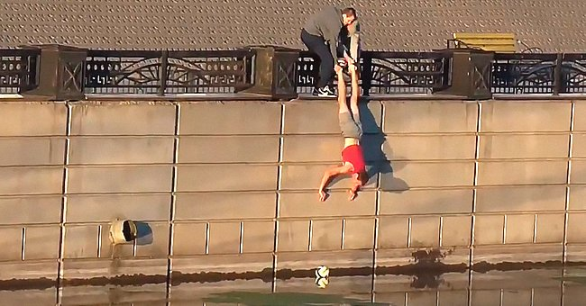 Watch Funny Video of Man Trying to Get a Ball from the River & Gets Dropped by His Friends