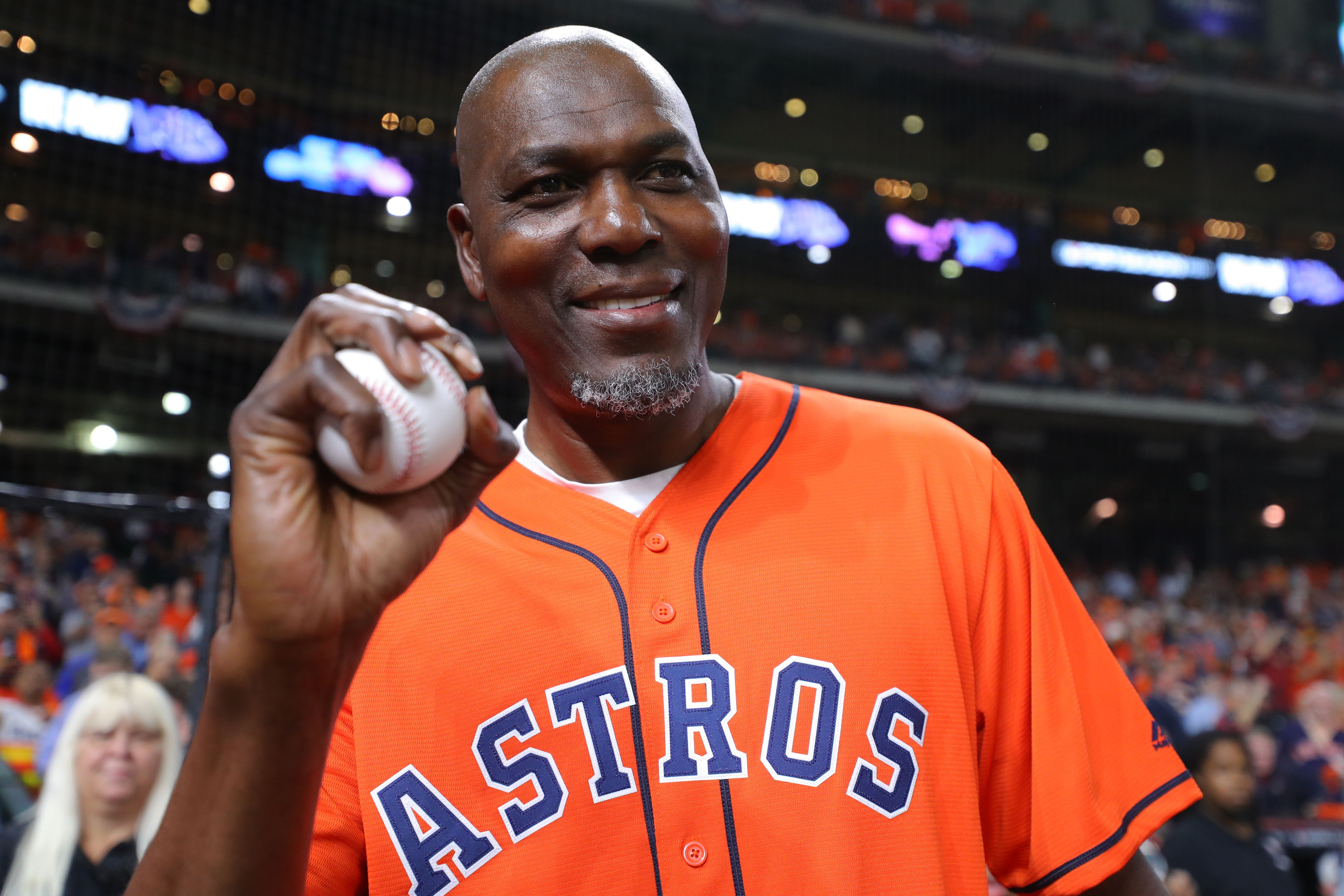 Hakeem Olajuwon holds the game ball prior to Game 6 of the 2019 World Series between the Washington Nationals and the Houston Astros at Minute Maid Park on Tuesday, October 29, 2019 in Houston, Texas. | Source: Getty Images