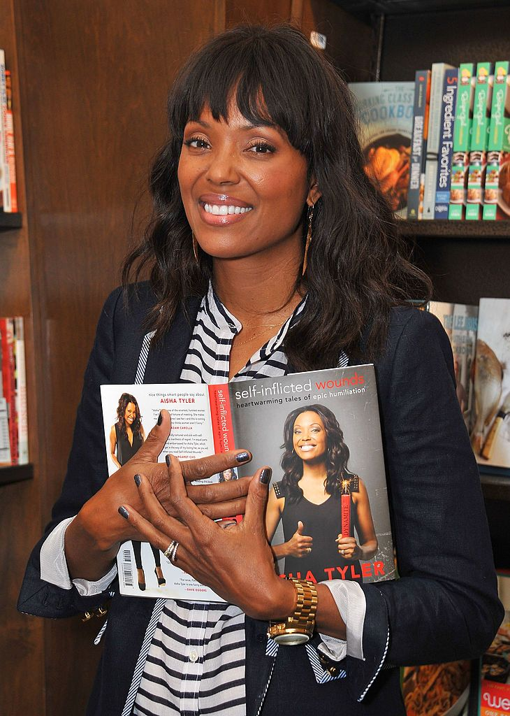 """Aisha Tyler with her new book """"Self-Inflicted Wounds: Heartwarming Tales Of Epic Humiliation"""" at Barnes & Noble 3rd Street Promenade on July 15, 2013 in Santa Monica, California. 