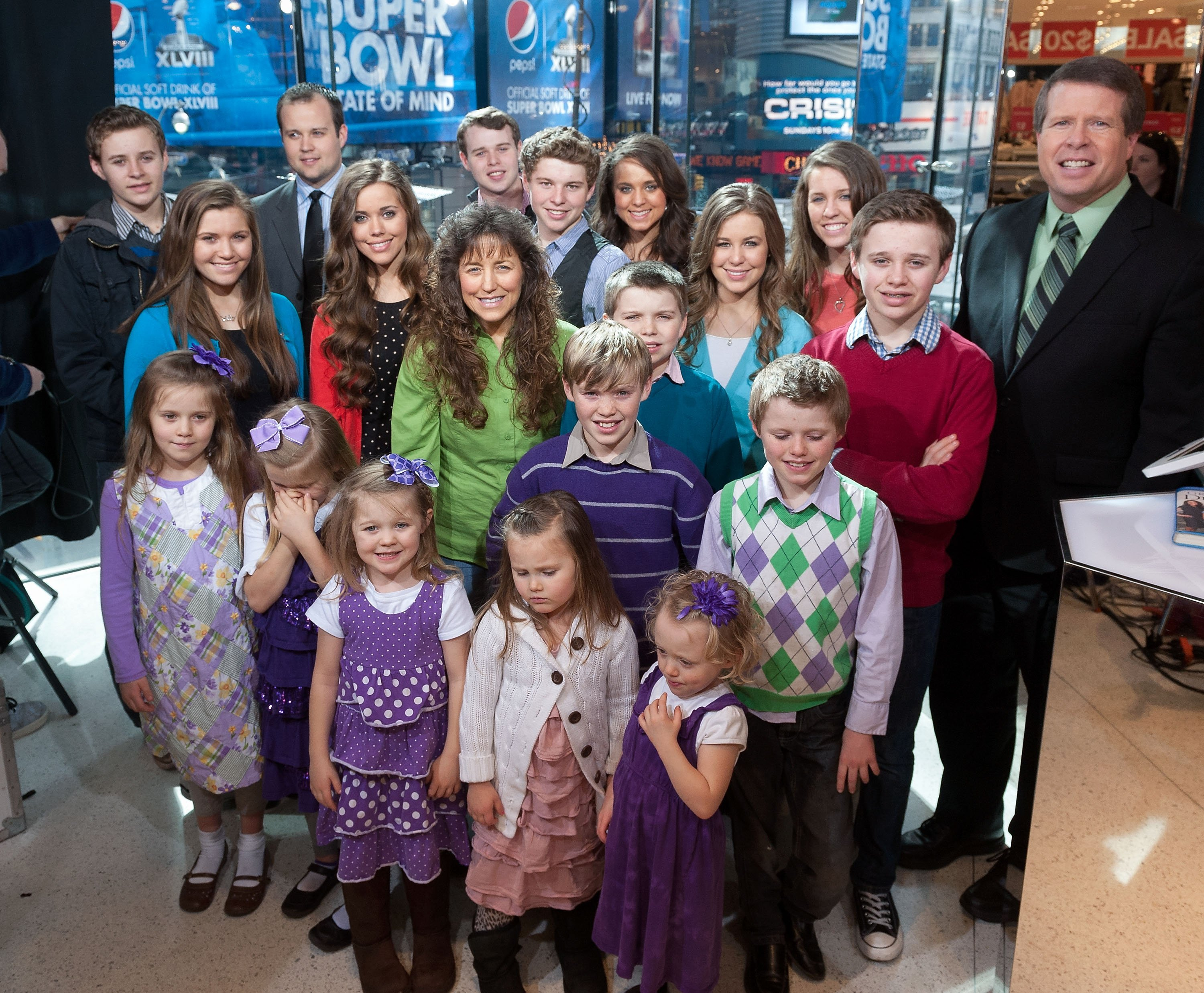 """The Duggar family visits """"Extra"""" at their New York studios at H&M in Times Square on March 11, 2014. 